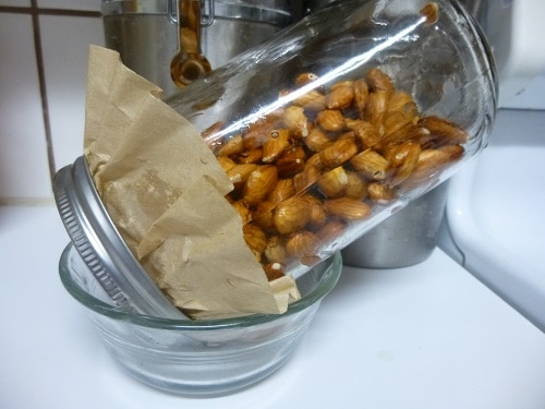 All you need to create sprouted almonds is 2 cups of raw almonds, filtered water, a quart jar with lid, a coffee filter, and a small bowl.