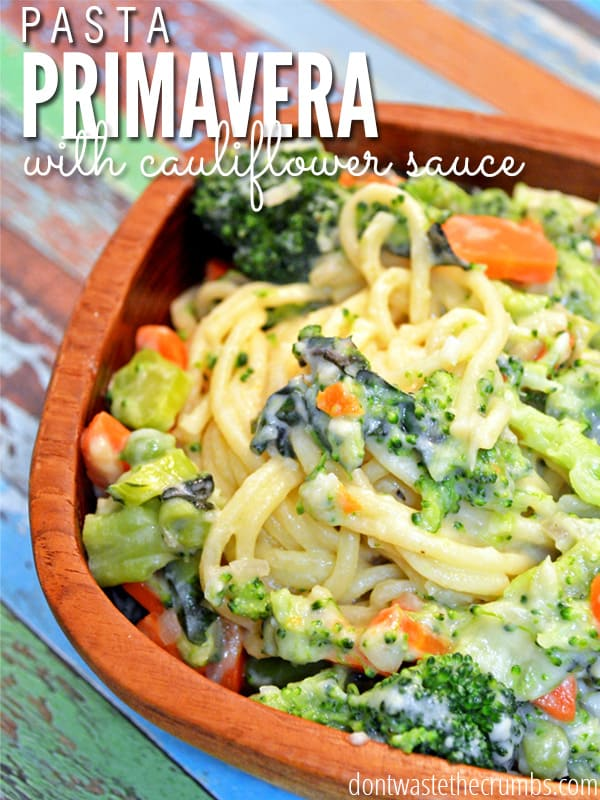 We love this dish! This Vegetable Pasta Primavera Recipe with Creamy Cauliflower Sauce is the perfect frugal dinner for meatless nights. It can be made with any vegetables you have in the kitchen and the best part is that the sauce is made of cauliflower - the kids won't even taste it! :: DontWastetheCrumbs.com