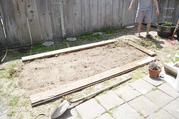 Wondering how to plant a garden without spending a fortune? Here's a picture tutorial showing how to build a raised garden bed for less than $15! :: DontWastetheCrumbs.com