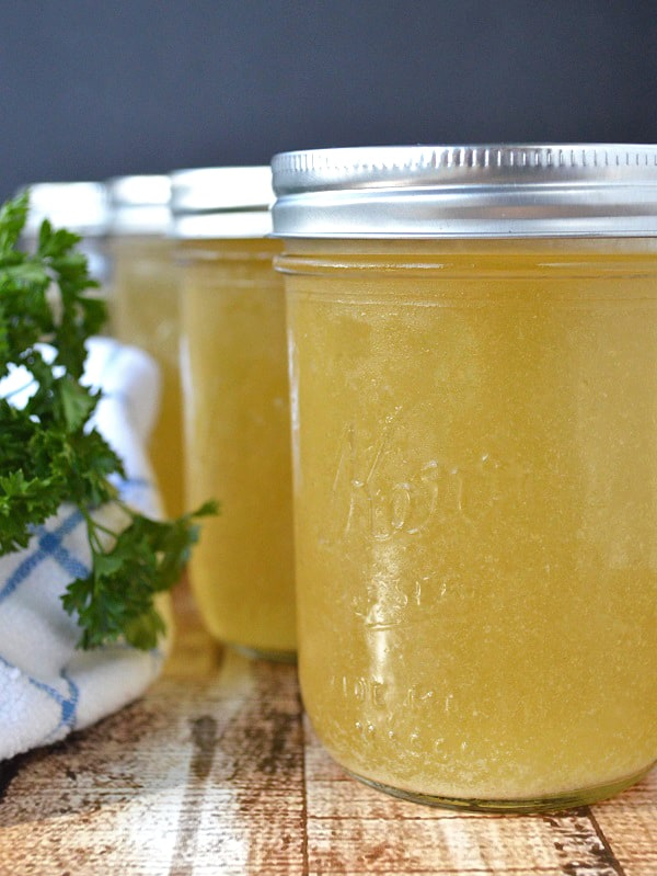 This slow cooker chicken stock is not only incredibly easy to make, but it's so much more flavorful than any chicken stock I've bought at the store. It costs just 1¢ per quart to make, so it saves me tons of money too! I'll never go back to store-bought stock again! :: DontWastetheCrumbs.com