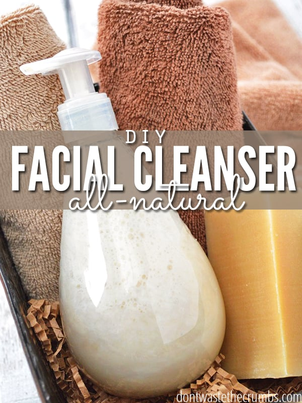 "Pump bottle with homemade face wash in a caddy with towels. Text overlay says, ""DIY Facial Cleanser: All Natural""."