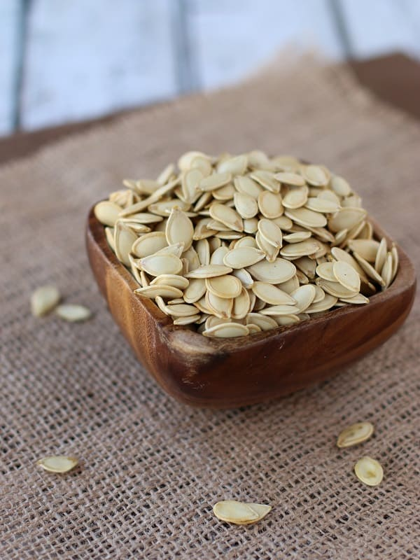 Learn how to clean and roast pumpkin seeds to get the best results in this simple homemade roasted pumpkin seed recipe.