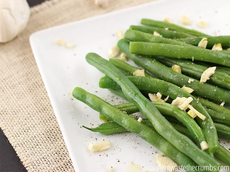 Simple, easy & flavorful, 5 ingredient garlic green beans. A wonderful, healthy, fresh side for and meal.Easy recipe which only takes a few minutes!