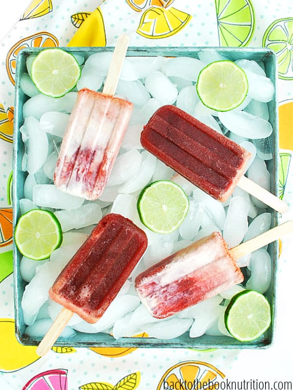 This easy recipe for homemade cherry limeade popsicles are like a cherry limeade fron Sonic, frozen on a stick! They're so good, so easy, and are way healthier (and cheaper) for you than any storebought dessert. I've added it to my favorite clean eating dessert collection for sure! :: DontWastetheCrumbs.com