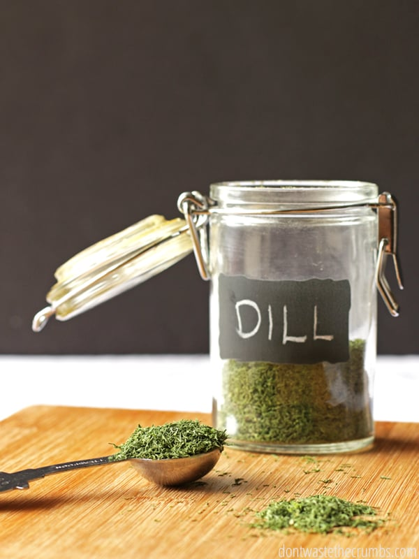 "Dehydrated dill in a jar with a label that says, ""Dill""."