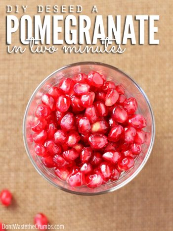 Clear glass bowl filled with beautiful red Pomegranate seeds sitting on a brown fiber tablecloth. Text overlay DIY Deseed a Pomegranate in Two Minutes.