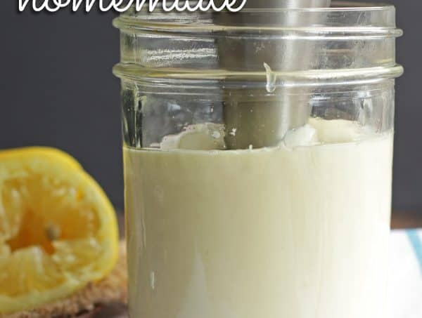 Mason jar filled with mayonnaise with an immersion blender inserted. Text overlay failproof Homemade Mayo.