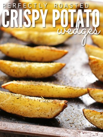 "Tray filled with crispy oven roasted potato wedges with text overlay, ""Perfectly Roasted Crispy Potato Wedges""."