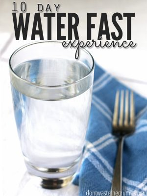"Glass of water with a blue napkin and fork. Text overlay says, ""10 Day Water Fast Experience""."