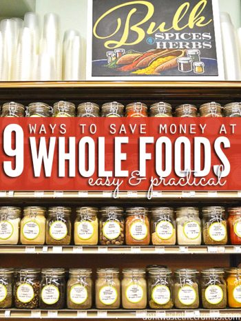 Grocery store shelf filled with labeled glass storage jars. A sign sits above the shelf reads Bulk Spices & Herbs.Text overlay 9 Easy & Practical Ways to Save Money at Wholefoods.