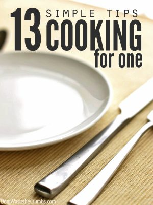 """Empty plate with knife and fork and text overlay, """"13 Simple Tips Cooking for One""""."""