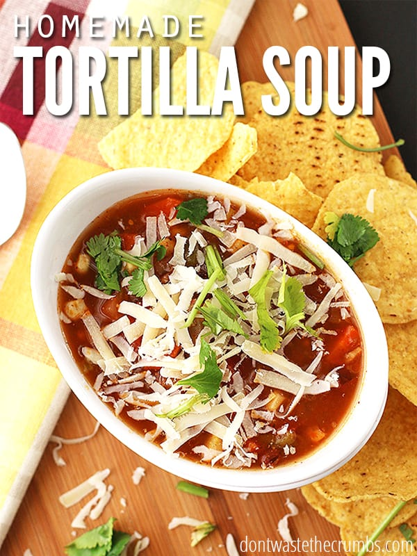 This tortilla soup is so simple and delicious - it's no wonder it's one of our favorite meals! Lots of veggies, beans and packed with flavor - topped with sour cream and cilantro and it's a great meal for company!  The best part - a whole pot can be made for less than $5! :: DontWastetheCrumbs.com