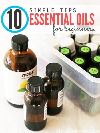 "Multiple bottles of essential oils inside a tub and sitting on a table with text overlay, ""10 Simple Tips: Essential Oils for Beginners""."