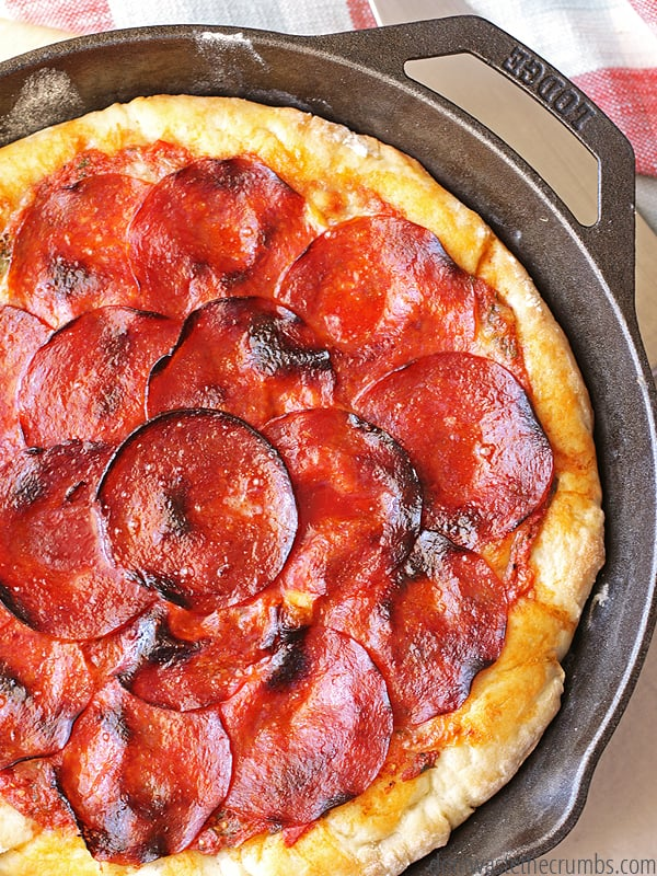 This homemade cast iron skillet pizza is thicker like Pizza Hut, but made from scratch with whole foods, so it's healthy pizza - for real! Homemade pizza just met it's match. Get the easy recipe and wow your family for dinner this weekend, while saving money and clean eating! :: DontWastetheCrumbs.com