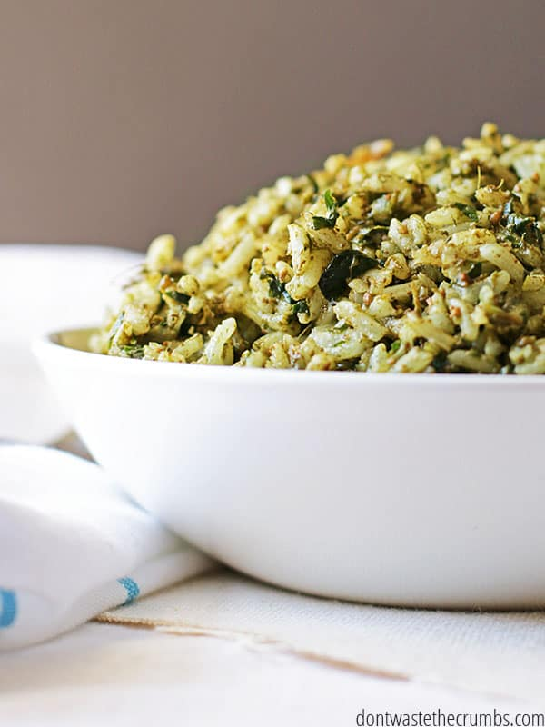 Easy and delicious risotto recipe for pesto risotto. plus a recipe for fresh homemade pesto! This amazing dish takes just minutes to make and tastes gourmet :: DontwWastetheCrumbs.com