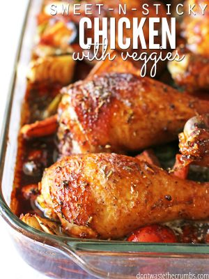 "Pan filled with veggies and chicken legs covered in a sticky sauce with text overlay, ""Sweet-N-Sticky Chicken with Veggies""."