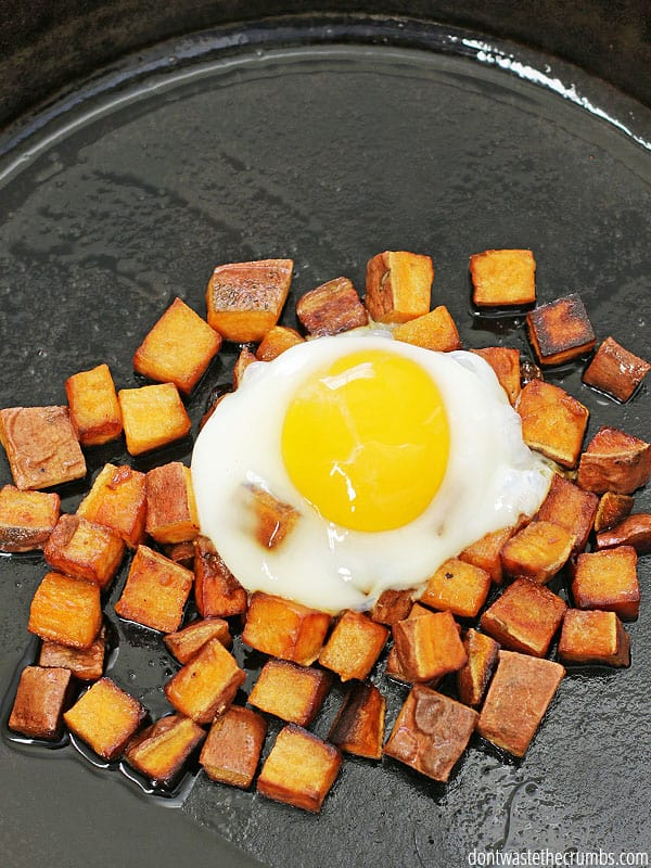 Fried sweet potatoes and runny eggs - a super easy recipe and a healthy breakfast that's ready in just a couple of minutes. It's perfect for using up leftover sweet potatoes and is naturally vegetarian, gluten-free and paleo. It's super cheap too - just 50¢ per serving! :: DontWastetheCrumbs.com