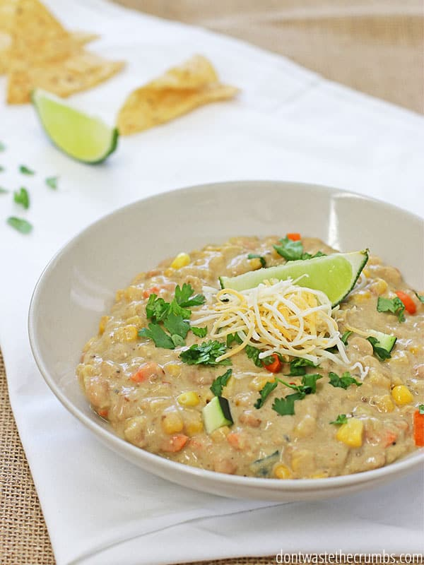 My family loves this easy recipe for slow cooker white chicken chili. Toss it all in the pot, set it to low and let the slow cooker make a delicious, kid-friendly dinner for you! The whole recipe can be made for about $7, is freezer-friendly and can easily be doubled for a crowd! :: DontWastetheCrumbs.com