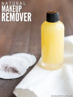 "Bottle of homemade makeup remover with cotton pads on a table with text overlay, ""Natural Makeup Remover""."