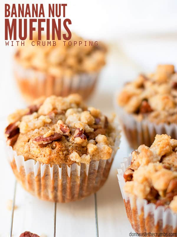 Banana nut muffins topped with pecans and a brown sugar crumb topping. They're easy to make, naturally sweetened and packed with banana and fall flavors. The whole family loves them! :: DontWastetheCrumbs.com