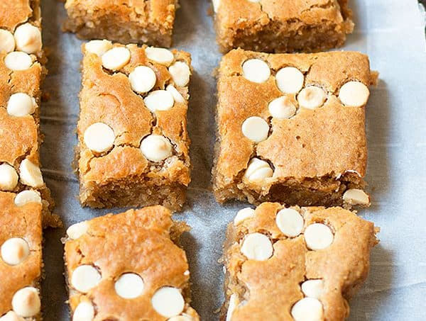 """Blondies cut into squares with text overlay, """"White Bean Blondies""""."""