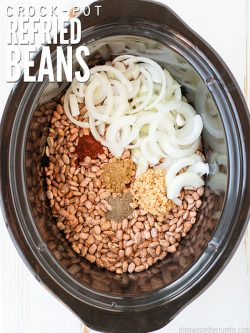 Skip the canned beans and learn how to make this authentic & easy Mexican crockpot refried beans recipe! Use dry/canned beans, or make refried black beans!