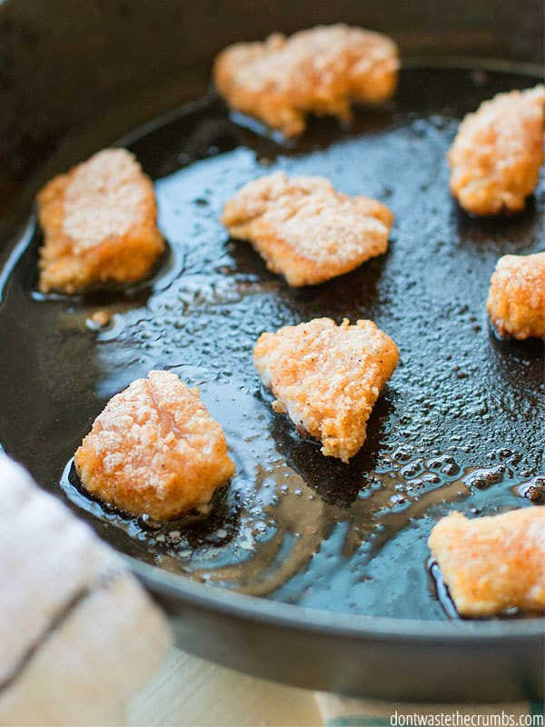 These healthy homemade chicken nuggets are PERFECT for mom's trying to feed their kids healthy alternatives to fast food. They taste amazing and are all real food ingredients. And even fried in healthy fat!