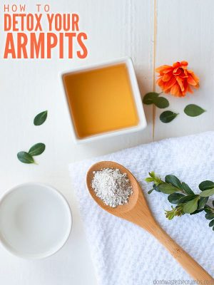 White bathroom counter with a round white bowl filled with water, a wooden spoon filled with Bentonite clay, and a square bowl with Apple Cider Vinegar. Text overlay How to Detox Your Armpits.