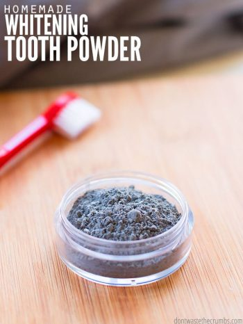 "Small jar of tooth whitening powder with a toothbrush. Text overlay says, ""Homemade Whitening Tooth Powder""."