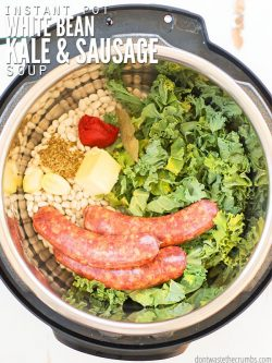 Overview of an Instant Pot, filled with white beans, sausage, spices and greens. Text overlay Instant Pot White Bean Kale & Sausage Soup.