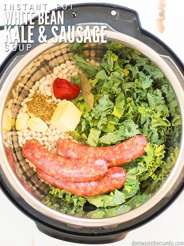 My favorite Instant Pot white bean soup includes kale and sausage. Use navy beans or great northern - there's no need to soak. It smells like little Italy! :: DontWastetheCrumbs.com