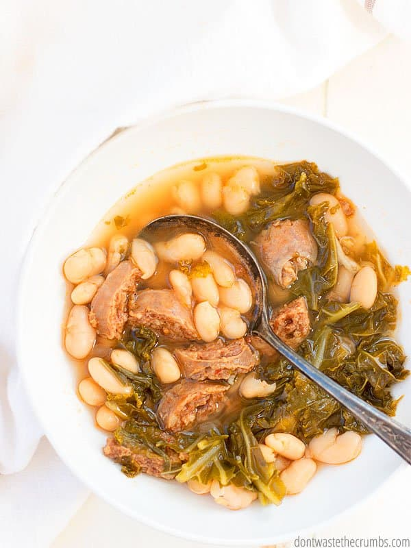 Making dinner quick doesn't mean you have to sacrifice flavor. Instant Pot white bean soup with sausage and kale is super flavorful plus its cheap and healthy!