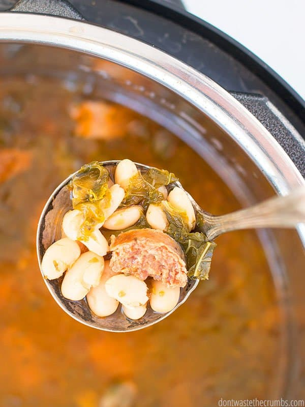 This Instant Pot white bean soup is PACKED with flavor. Adding sausage and kale makes it even more delicious!