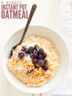 Round white bowl filled with oatmeal, topped with blueberries and coconut flakes. Text overlay 4 Minute Instant Pot Oatmeal.