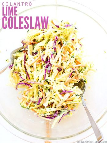 A glass dinner bowl filled with richly colored red and green sliced cabbage, tossed as a slaw. A fork sits ready to use. Text overlay Cilantro Lime Coleslaw.