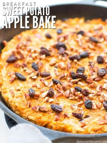 Cast iron skillet filled with golden brown, shredded back potatoes, topped with raisins and pecans. Text overlay Breakfast Sweet Potato Apple Bake.