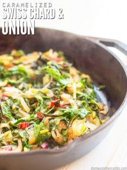 Cast iron skillet filled with steaming Swiss Chard and caramelized onions. Text overlay Caramelized Swiss Chard & Onion.