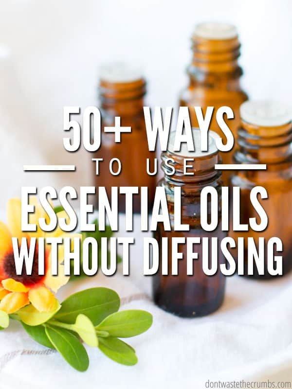 Four amber colored essential oil bottles fading into the background with a yellow flower in the foreground. Text overlay 50+ Ways to use Essential Oils Without Diffusing.