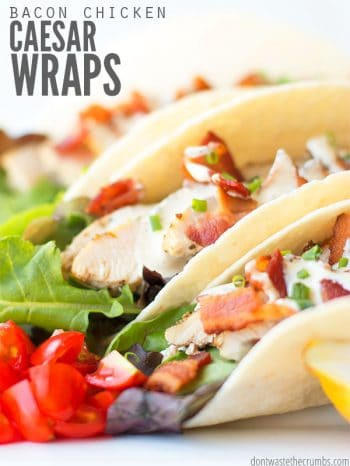 Two flour tortillas wraps overflowing with sliced chicken, bacon bits, leaf lettuce, diced tomatoes, all dressed ranch dressing. Text overlay Bacon Chicken Caesar Wraps..