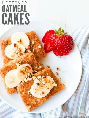 "Oatmeal cakes on a plate topped with sliced bananas, chopped nuts and strawberries on the side. Text overlay says, ""Leftover Oatmeal Cakes""."