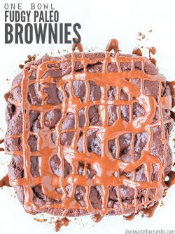 Huge brownie with chocolate sauce drizzled in a criss-cross pattern. Text overlay One Bowl Fudgy Paleo Brownies.