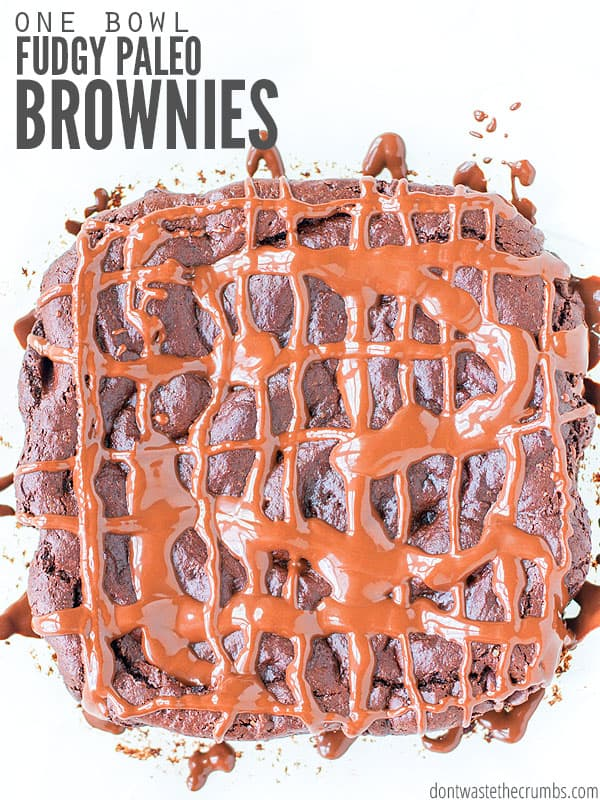 These simple triple fudgy paleo brownies uses almond butter & almond flour & are AMAZING. They're gluten-free, one-bowl and one easy swap makes them vegan. :: DontWastetheCrumbs.com