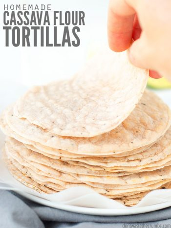 "Stack of tortillas with a woman's hand lifting one up. Text overlay says, ""Homemade Cassava Flour Tortillas""."