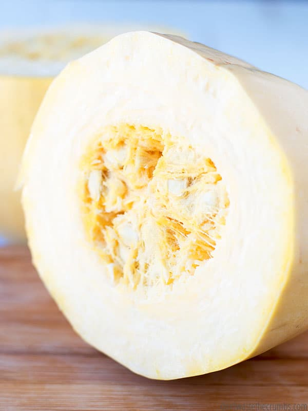 Learn how to cook a spaghetti squash! How to cut it, how long to cook in the Instant Pot, and ideas on how to eat it!