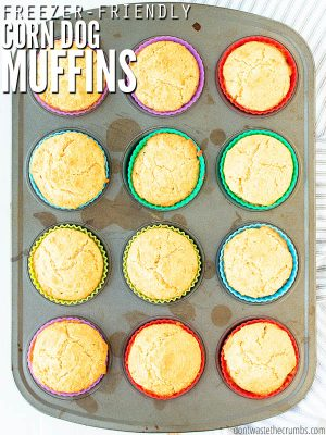 "Muffin tin with muffins and text overlay, ""Freezer Friendly Corn dog Muffins""."