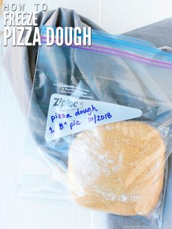 Raw pizza dough in a dated freezer Ziploc bag. Text overlay How to Freeze Pizza Dough.