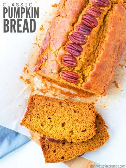 Sliced pumpkin bread loaf with pecans on a white kitchen counter. Text overlay Classic Pumpkin Bread.