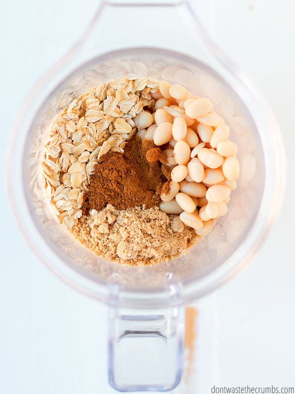 Ingredients (oats, white beans, cinnamon and sugar) in a blender.