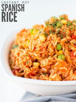 My family LOVES this Instant Pot Spanish Rice recipe with beans or ground beef on Mexican night - the seasoning makes it taste so authentic - without Rotel! : : DontWasteTheCrumbs.com