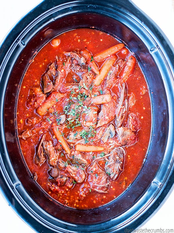 Crockpot filled with finished beef ragu.